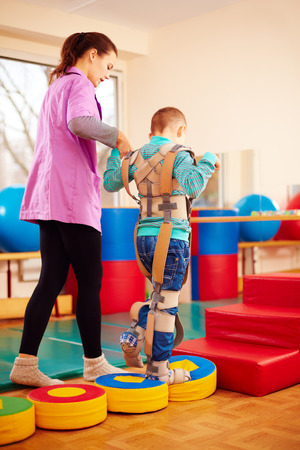 cute kid having physical musculoskeletal therapy in rehabilitation center Stock Photo