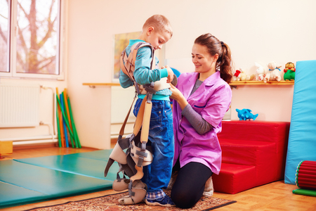 cerebral palsy: cute kid is going to have physical musculoskeletal therapy in rehabilitation center