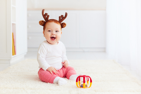 dear: beautiful happy baby dear playing with toy at home Stock Photo