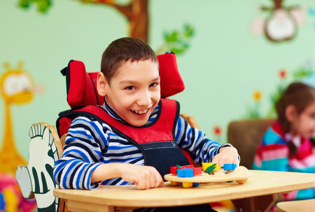 cheerful boy with disability at rehabilitation center for kids with special needs Stock fotó - 66299032