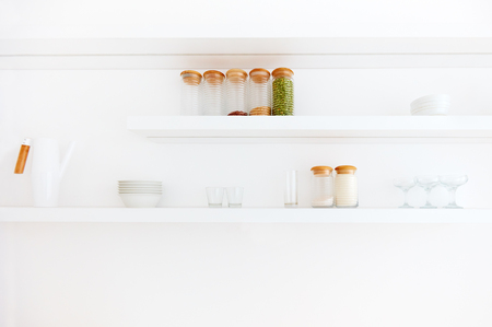 contemporary kitchen: white hanging shelves in contemporary kitchen in eco style Stock Photo