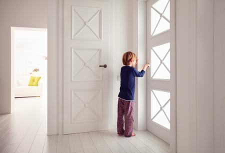 keek: young boy opens the door at home