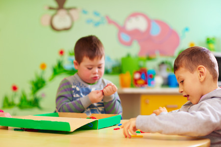 kids with special needs develop their fine motility skills in daycare rehabilitation center