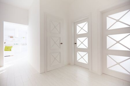 corridors: several wooden doors with decorative glass inserts in corridor of modern apartment