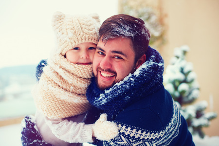 outer clothing: portrait of happy father and kid playing outdoors in winter