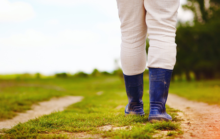 low view of farmer walking along the rural countryside road Stock Photo