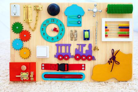 handmade busy board for baby fine motility skills development