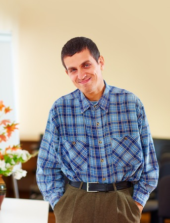 portrait of cheerful adult man with disability in rehabilitation center