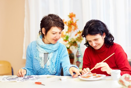 adult woman with special needs are engaged in handcraft in rehabilitation center Stock Photo