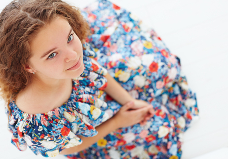portrait of cute young girl in frilly summer dress