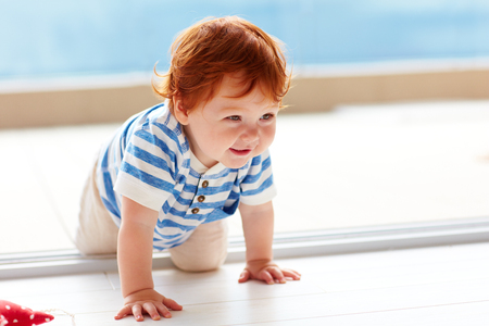 cute smiling toddler baby crawling on the floor 스톡 콘텐츠