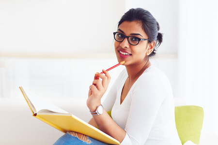 beautiful young indian girl, student with book, studying Stockfoto