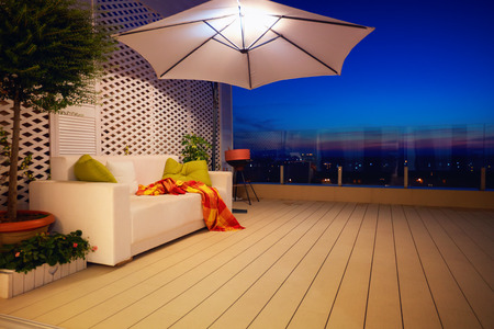 beautiful modern rooftop patio, terrace with evening city view Stock Photo