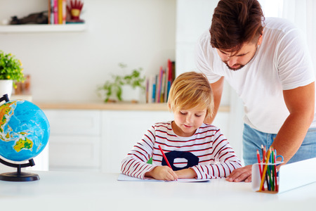 father and son at the desk, educating at home