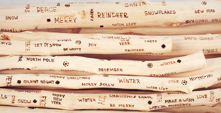 background of christmas greeting inscription burned on driftwood
