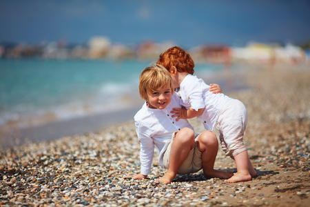 Funny candid moment of kid catching his little baby brother, when hes falling, family summer vacation