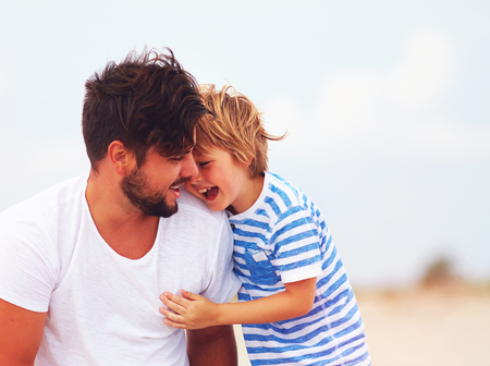 candid image of father and son laughing, having fun together Stok Fotoğraf