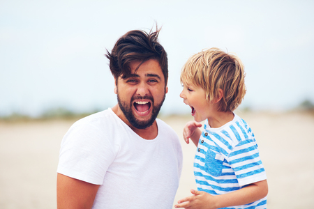 portrait of father and son, kid yelling, making strong sound. people expressions Stock Photo