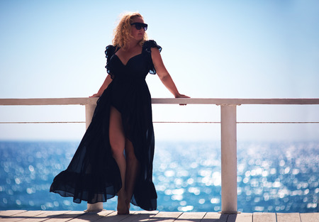 body positive, plus size woman enjoys summer day