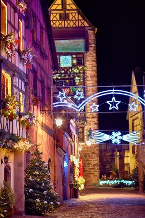 fairytale christmas street Rue du General de Gaulle of beautiful medival village Riquewihr, Alsace, France