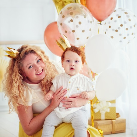 portrait of mother and cute little baby boy on his 1st birthday party