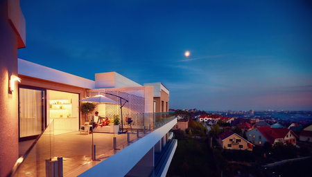 family relaxing on roof top patio with evening city view Standard-Bild