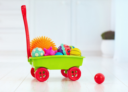 colorful toy trolley full of different tactile balls for kids