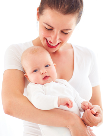 portrait of young mother with three months old infant baby girl Reklamní fotografie