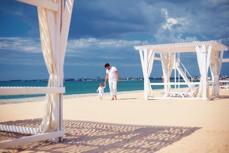 happy family walking on sandy beach, summer vacation