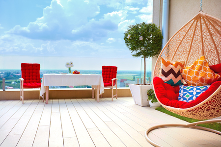 relaxing furnished area on roof top patio area at warm summer day