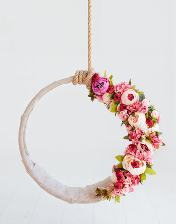 newborn baby photography swing, DIY floral hanging hoop Stock Photo