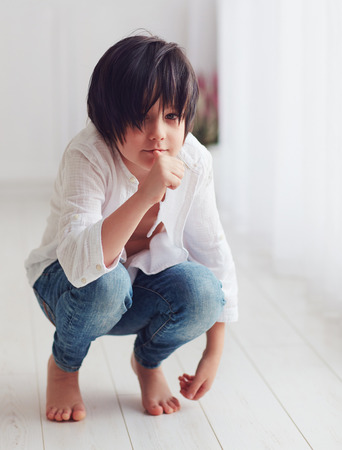 anime manga young boy character posing barefoot in bright room, sucking his finger