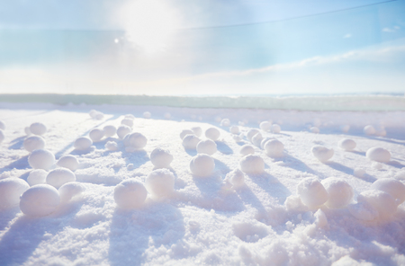 a lot of snowballs on the snow at sunny frosty winter morning Stock Photo