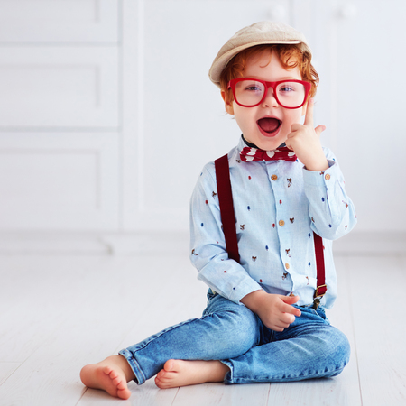 portrait of beautiful redhead toddler baby boy 写真素材