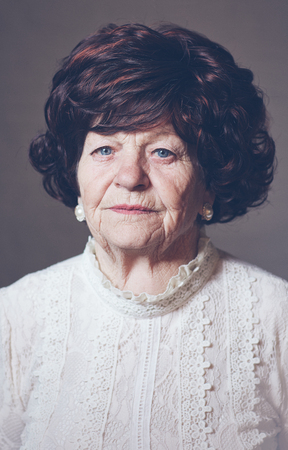 portrait of beautiful aged adult woman, 80 years old