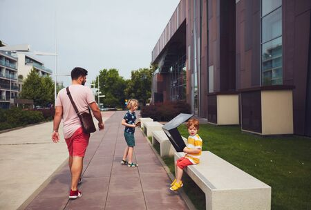 WARSAW, POLAND - June 20, 2019: Family, father with kids are going to enter the Copernicus Science Centre in Warsaw, Poland Redakční