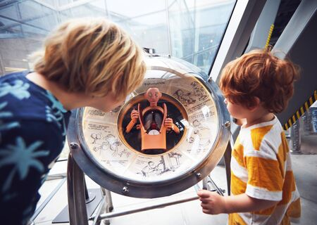 WARSAW, POLAND - June 20, 2019: Kids are testing the internal human body organs globe model in the Copernicus Science Centre in Warsaw, Poland