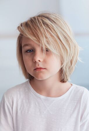 portrait of cute , ten years old boy with blonde hair