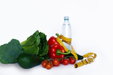 Healthy food for diet, vegetables with measurement tape on white background.