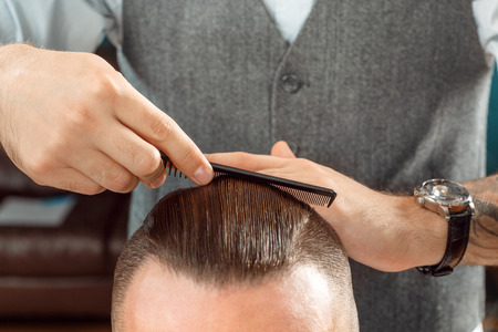 hair salons: Hair styling by a professional barber
