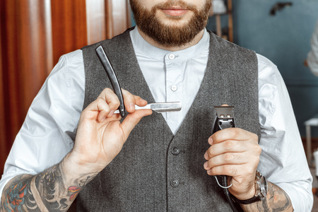 Barber testing the sharpness of a blade