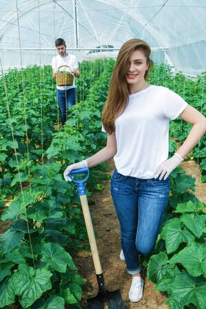collate: Farmer with a shovel smiling directly at the camera Stock Photo