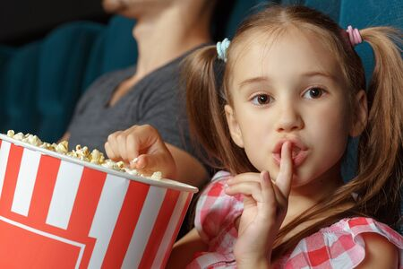 pigtail: Little girl asking silence during the movie