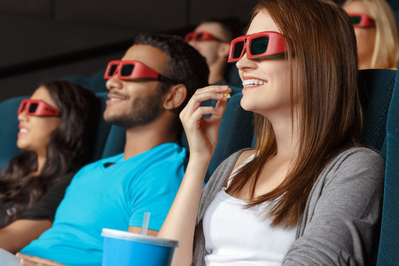 man with glasses: Friends watching 3D movie in the cinema