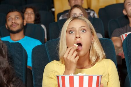 Young girl watching a movie with admiration