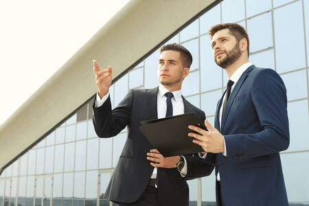 business project: Two business partners discussing new project outdoors Stock Photo
