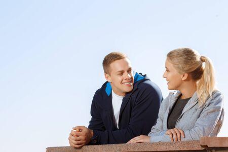 two friends talking: Two friends talking during a break outdoors