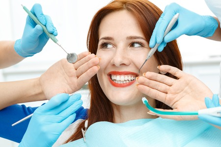 mouth smile: Attractive girl in the dentist chair showing the perfect smile Stock Photo