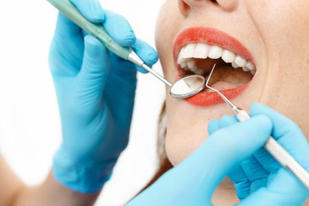 Young girl with beautiful teeth having a dental checkup