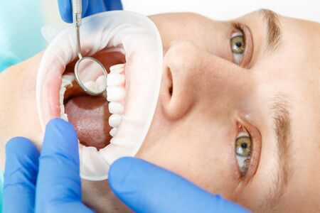 dental clinics: Using security editor lips during the inspection in dental office Stock Photo